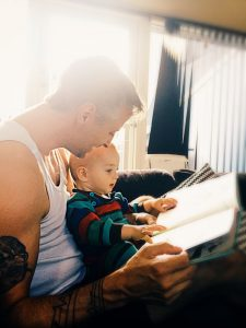 father reading to his son