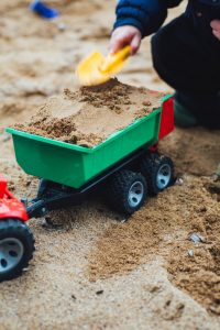 playing in sand pit